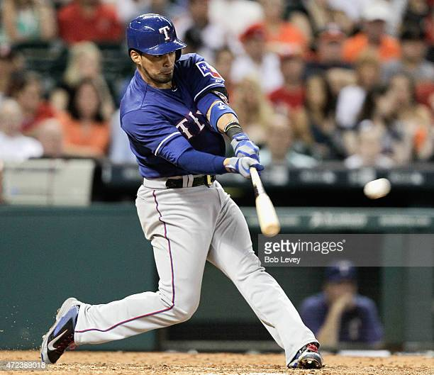 Robinson Chirinos of the Texas Rangers doubles in the third inning against the Houston Astros at Minute Maid Park on May 6 2015 in Houston Texas