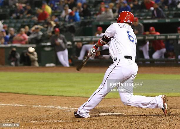 Robinson Chirinos of the Texas Rangers hit the go ahead run for Adrian Beltre to score in the eighth inning against the Atlanta Braves at Globe Life...