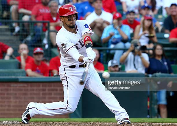 Robinson Chirinos of the Texas Rangers hits a RBI single in the seventh inning against the Toronto Blue Jays in game four of the American League...