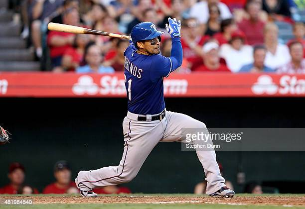 Robinson Chirinos of the Texas Rangers hits an RBI double in the fourth inning against the Los Angeles Angels of Anaheim at Angel Stadium of Anaheim...