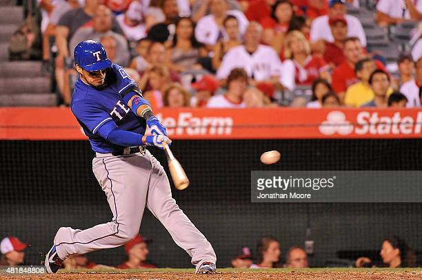 Robinson Chirinos of the Texas Rangers hits an RBI single in the fifth inning during a game against the the Los Angeles Angels of Anaheim at Angel...