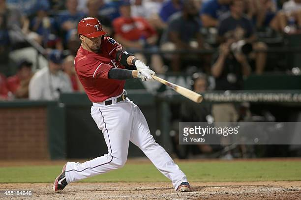 Robinson Chirinos of the Texas Rangers hits in the fifth inning against the Kansas City Royals at Globe Life Park in Arlington on August 23 2014 in...