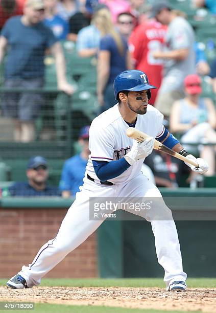 Robinson Chirinos of the Texas Rangers hits in the fifth inning against the Cleveland Indians at Globe Life Park in Arlington on May 17 2015 in...