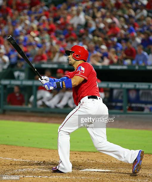 Robinson Chirinos of the Texas Rangers hits in the fourth inning against the Minnesota Twins at Globe Life Park in Arlington on July 9 2016 in...