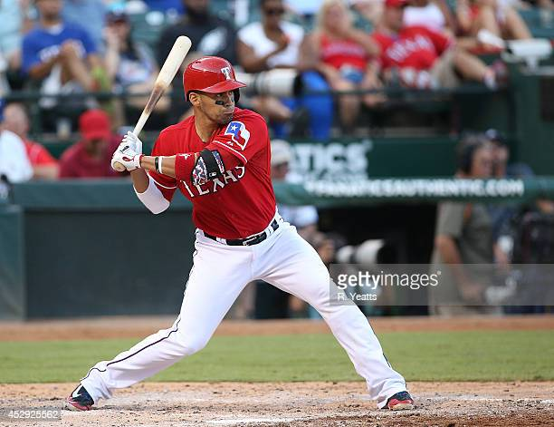 Robinson Chirinos of the Texas Rangers hits in the third inning against the Los Angeles Angels of Anaheim at Globe Life Park in Arlington on July 12...