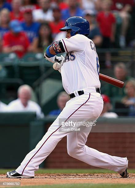 Robinson Chirinos of the Texas Rangers is hit with a pitch during a game against the Chicago White Sox at Globe Life Park in Arlington on June 2 2015...