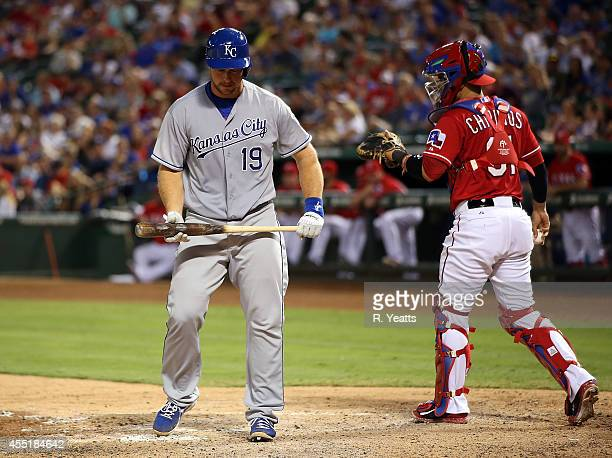 Robinson Chirinos of the Texas Rangers looks on as Erik Kratz of the Kansas City Royals reacts after stirking out in the fifth inning against the...