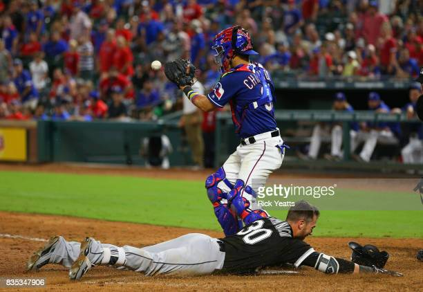 Robinson Chirinos of the Texas Rangers misses the tag on Nicky Delmonico of the Chicago White Sox in the park home ruin in the eighth inning at Globe...