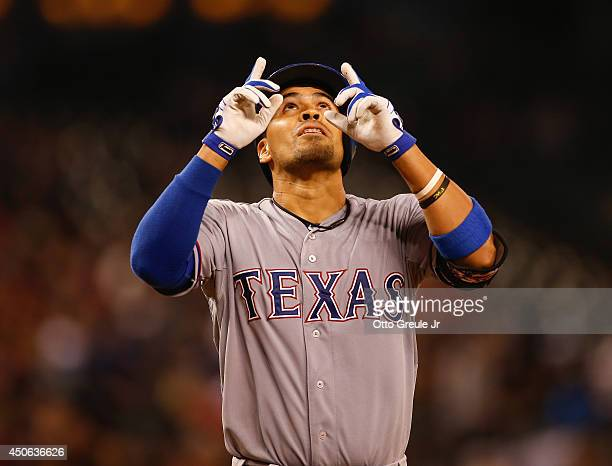 Robinson Chirinos of the Texas Rangers points skyward as he crosses home plate after hitting a tworun home run in the sixth inning against the...