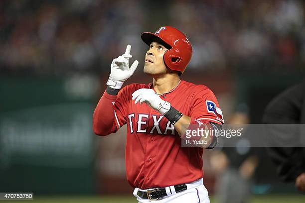 Robinson Chirinos of the Texas Rangers points to the sky after scoring in the sixth inning against the Houston Astros at Globe Life Park in Arlington...