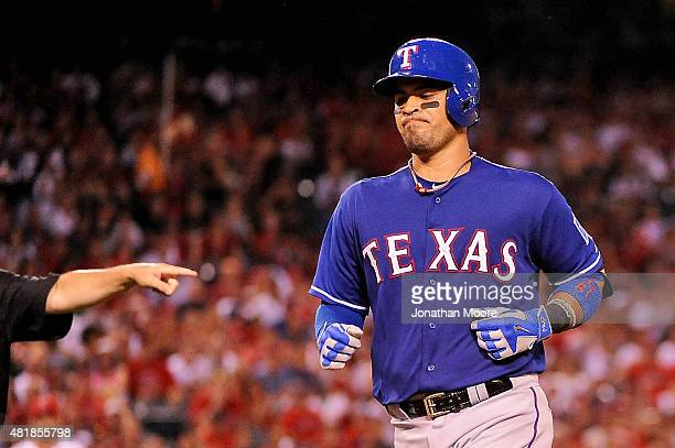 Robinson Chirinos of the Texas Rangers reacts after being forced out at first base by Erick Aybar of the Los Angeles Angels of Anaheim in the fifth...