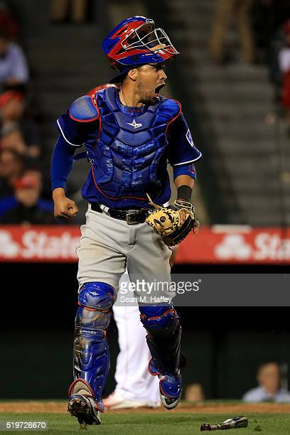 Robinson Chirinos of the Texas Rangers reacts to a double play to end the eighth inning d of a baseball game against the Los Angeles Angels of...