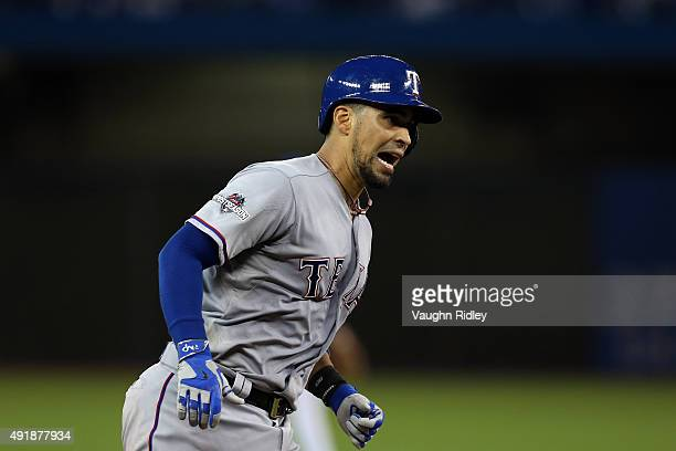 Robinson Chirinos of the Texas Rangers rounds the bases after hitting a two run home run to left center field against David Price of the Toronto Blue...