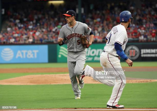 Robinson Chirinos of the Texas Rangers scores a run in front of Charlie Morton of the Houston Astros in the third inning at Globe Life Park in...