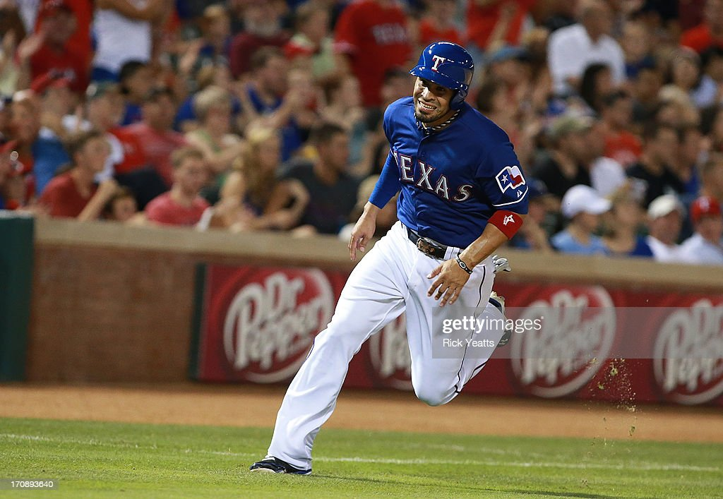 Robinson Chirinos #61 of the Texas Rangers scores in the sixth inning against the Oakland Athletics at Rangers Ballpark in Arlington on June 19, 2013 in Arlington, Texas.