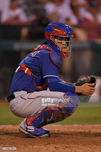 Robinson Chirinos of the Texas Rangers sets up behind the plate during the game against the Los Angeles Angels of Anaheim at Angel Stadium of Anaheim...