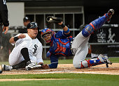 Robinson Chirinos of the Texas Rangers tags out Avisail Garcia of the Chicago White Sox at home plate during the fourth inning on June 19 2015 at U S...