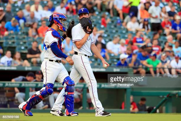 Robinson Chirinos of the Texas Rangers talks with Cole Hamels of the Texas Rangers as the Rangers take on the Detroit Tigers in the top of the second...