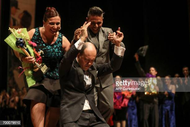 Robiro Ocampo celebrates after winning in the Salon category at the Tango Dancing Tournament during the XI International Tango Festival in Medellin...