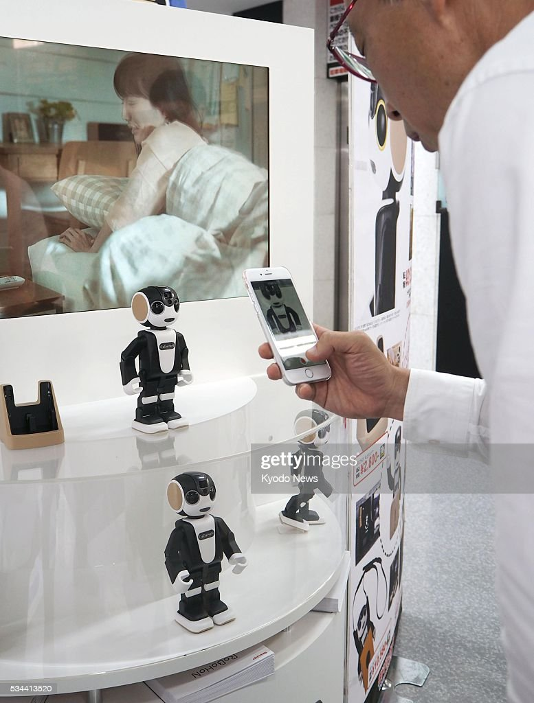 RoBoHoN humanoid robot phones are displayed at a mass retailer in Osaka on May 26, 2016. The phones, launched by Sharp Corp., are equipped with artificial intelligence features so they can converse with users, in addition to providing basic functions such as a camera.
