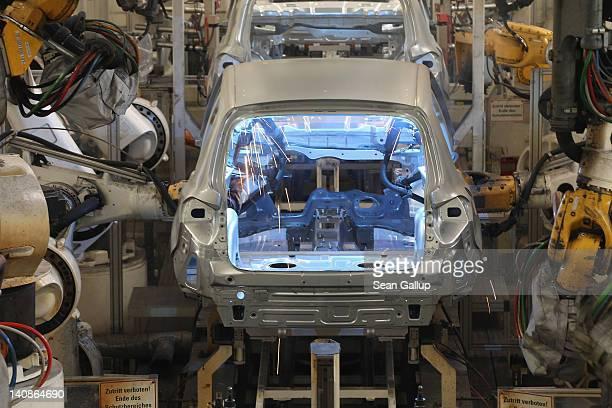 Robost weld the bodies of Volkswagen Tiguan cars at the Volkswagen factory on March 7 2012 in Wolfsburg Germany In 2011 Volkswagen achieved record...