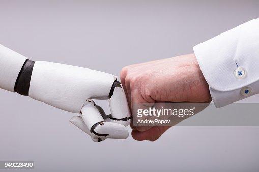 Robot And Human Hand Making Fist Bump : Foto de stock