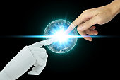 Robot and human hands touching on black background, Artificial Intelligence Technology Concept