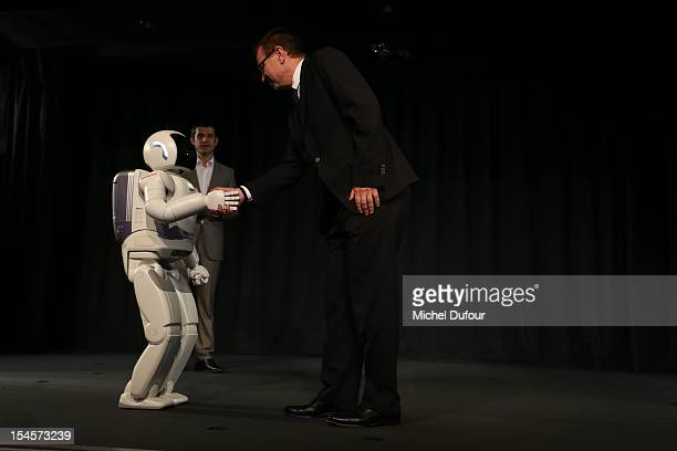 Robot Asimo and Olivier Courtin attend the Arthritis Foundation Gala Dinner at Pavillon Gabriel on October 22 2012 in Paris France