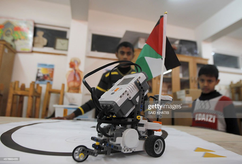 A Robot built from Lego bricks and bearing the Palestinian flag is seen during a robotics workshop for Palestinien school students organised by the United Nations Relief and Works Agency for Palestine Refugees (UNRWA) in Rafah town, in the southern Gaza Strip, on December 19, 2013.