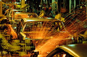 Robot car production line,sparks showering from body welding section