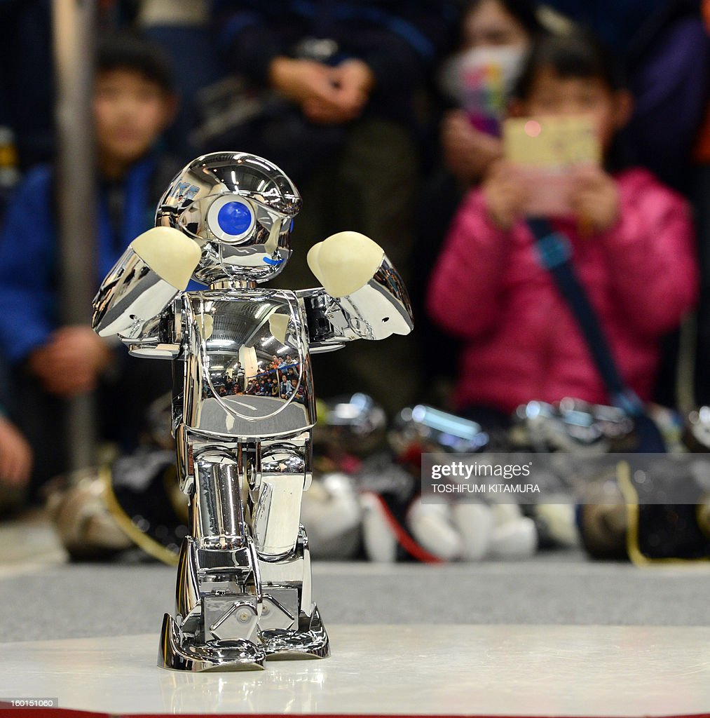 A robot, 'Chrome Manoi' peforms in the dancing contest during the Robot Athlete Cup competiton in Yokohama on January 27, 2013. The robots compete in six categories including dancing, autonomy beach flag, autonomy 20-metre walking and free performance in the competition. AFP PHOTO / TOSHIFUMI KITAMURA