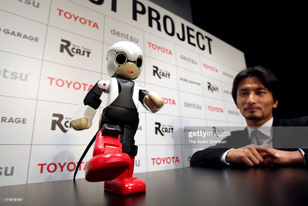 Robot creator Tomotaka Takahashi displays a humanoid robot 'Kirobo' during its reveiling on June 26, 2013 in Tokyo, Japan. The 34-centimeter-high, 1-kilogram humanoid robot will be sent into space in August and be a company for Japanese astronaut.