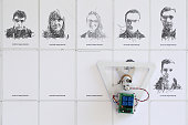A robot designed by Google Inc's creative labs completes line drawings from photographs taken on a smartphone at at the Mobile World Congress in...