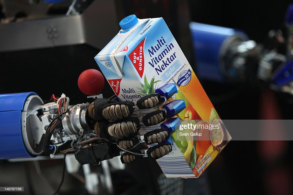 A robot developed by the Karlsruhe Institute of Technology retrieves a carton of juice in a presentation on the first day of the CeBIT 2012 technology trade fair on March 6, 2012 in Hanover, Germany. CeBIT 2012, the world's largest information technology trade fair, will run from March 6-10, and advances in cloud computing and security are major features this year.