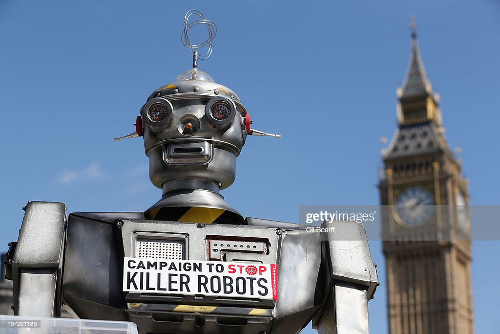 A robot distributes promotional literature calling for a ban on fully autonomous weapons in Parliament Square on April 23 2013 in London England The...