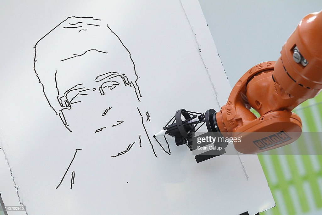 A robot draws a portrait from a photograph at the Fraunhofer stand on the first day of the CeBIT 2012 technology trade fair on March 6, 2012 in Hanover, Germany. CeBIT 2012, the world's largest information technology trade fair, will run from March 6-10, and advances in cloud computing and security are major features this year.