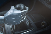 Robot hand on car gearstick. Robot pilot is driving a car. Automatic driver concept.