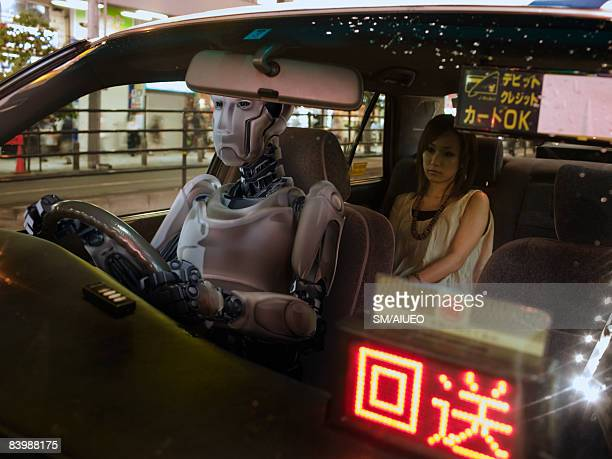 Robot driving a taxi