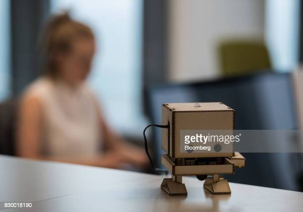 A robot figurine sits on a desktop in the industry lab at the International Business Machines Corp Watson cognitive computing platform IoT center in...
