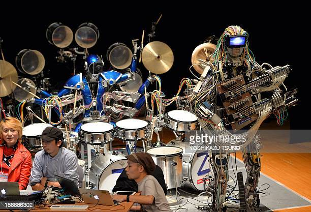 Robot guitarist 'Mach' and a robot drummer 'Ashura' members of a robot rock band 'ZMachines' perform music during the two day art and technology...