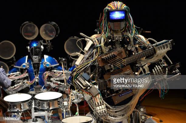 Robot guitarist 'Mach' and robot drummer 'Ashura' members of a robot rock band 'ZMachines' perform music during the two day art and technology event...
