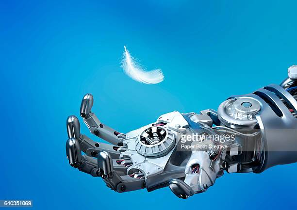 Robot hand catching a delicate white feather