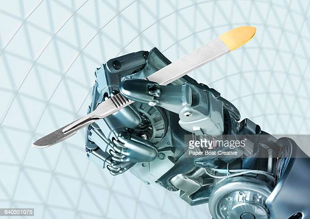 Robot hand holding a surgeon's scalpel