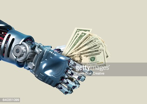 Robot hand holding lots of dollar notes : Stock Photo