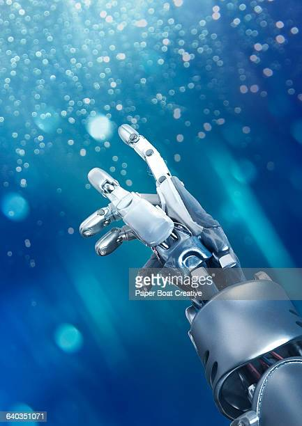 Robot hand pointing up at the glowing sky