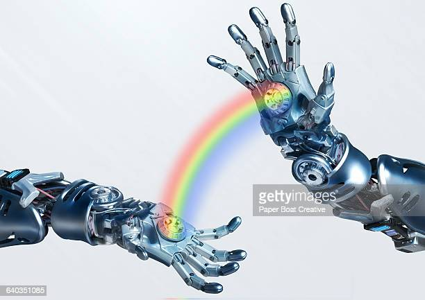 Robot hands with a rainbow passing through
