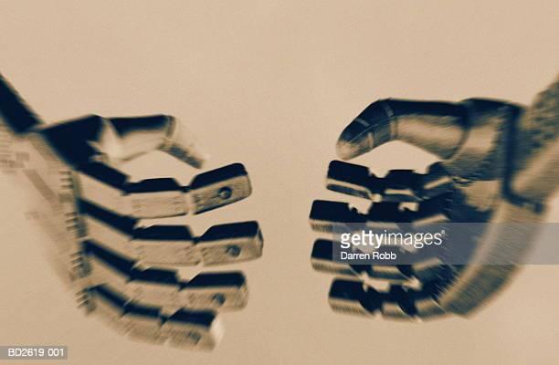 Robot handshake, close-up (toned B&W)