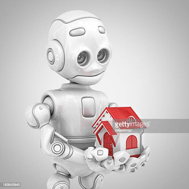 robot holding house