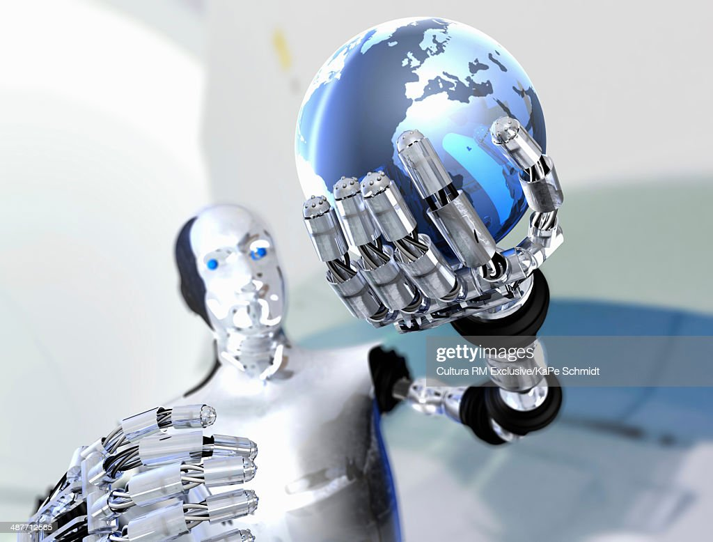 Robot holding up model of planet Earth : Stock Photo
