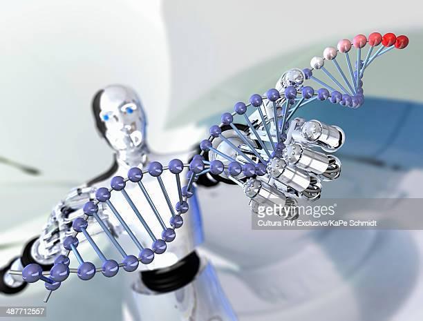 Robot holding up molecular model of DNA